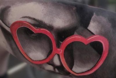 Black and Grey Portrait with Red Heart Shaped Glasses
